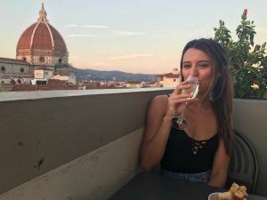 Alex at a rooftop bar overlooking the duomo in Florence, Italy