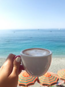 Cappuccino overlooking the ocean in Cinque Terre Italy